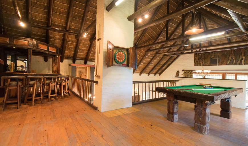 Games and entertainment room, includes a pool table. dartboard and board games