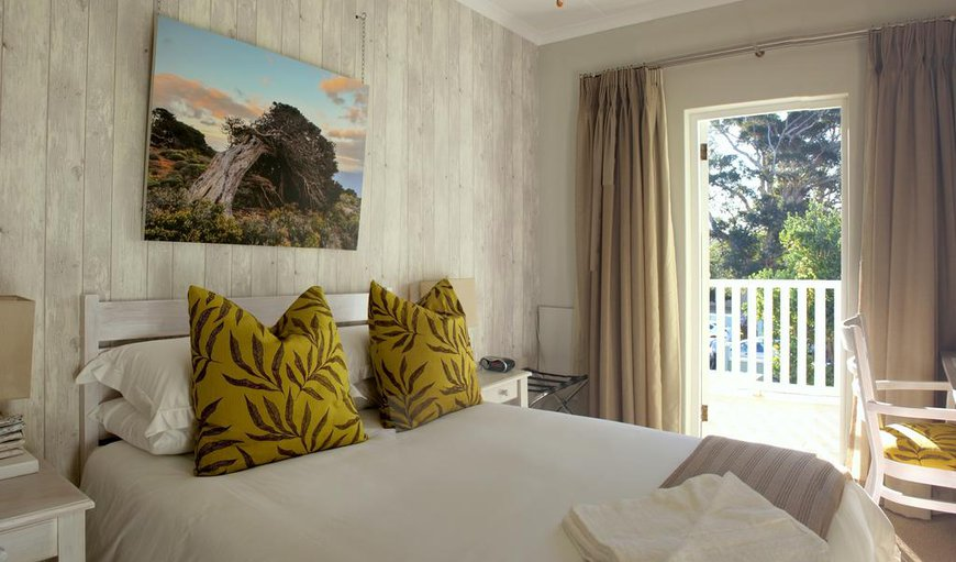 The Juniper Room has a double bed with a balcony