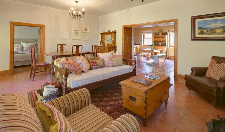 Open plan lounge/dining area with fireplace in 1830 Cottage