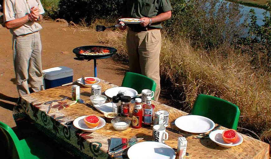 Breakfast time in the Kruger Park overlooking a water hole - prepared for you  by our guide