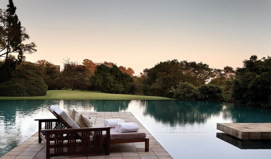 Enjoy views of the alluring gardens, the hotel's focal point, the infinity pool, and beyond.