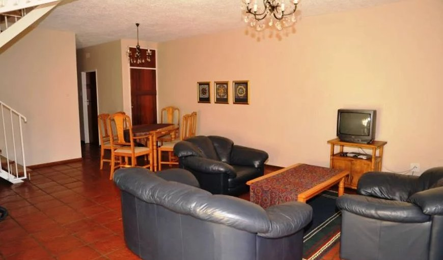 7 Sleeper unit-  Open plan lounge & dining room with a TV with DSTV.