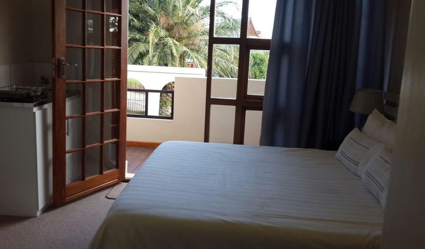 Room 1 has a double bed in a spacious room