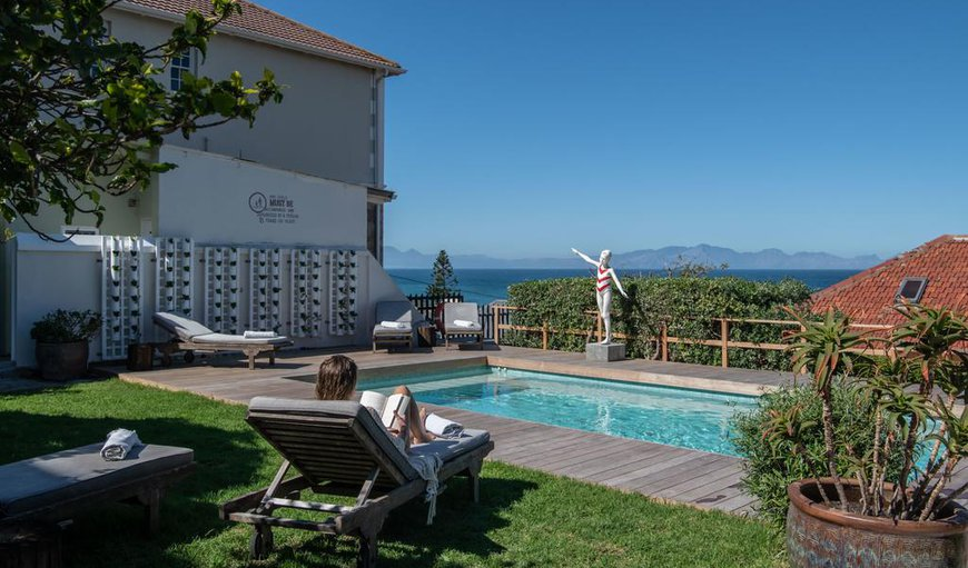 The guest house offers an outdoor swimming pool with loungers and a spectacular view.