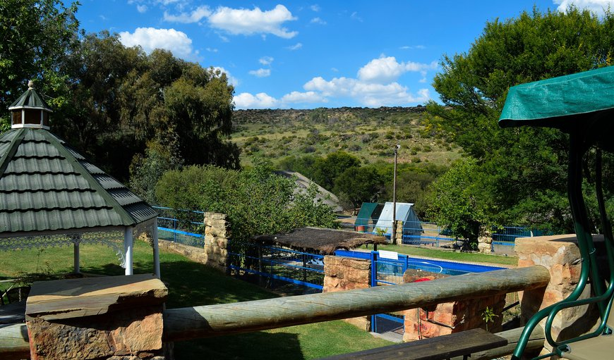 The beautiful view from the dining hall area of the swimming area and the opposite mountain where the game often come down to graze in the late afternoon. in Kommissiepoort, Free State Province, South Africa
