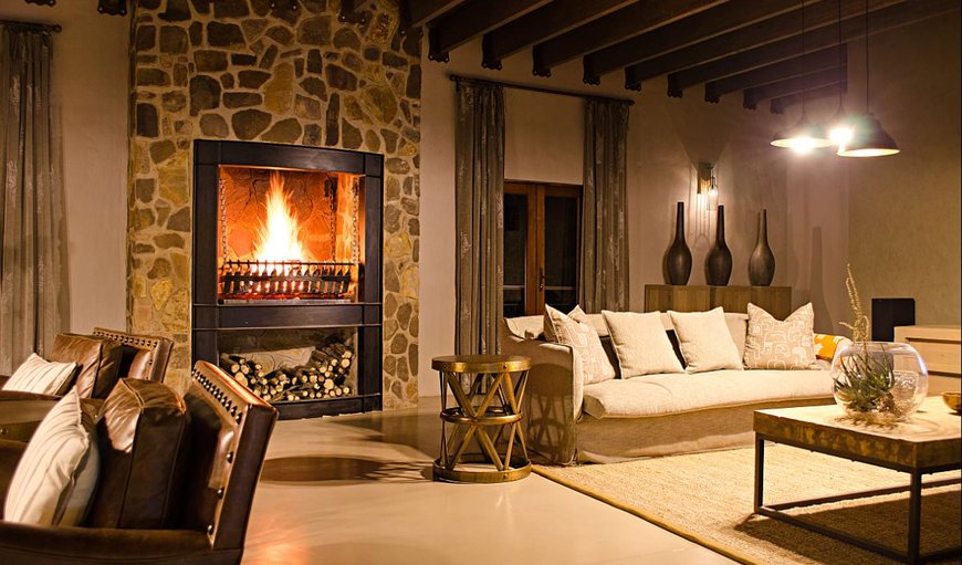 Bongela Private Game Lodge lounge area with a fireplace.