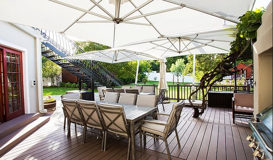 The Browns' Luxury Guest Suites with a table and chairs outside on the deck. in Dullstroom, Mpumalanga, South Africa