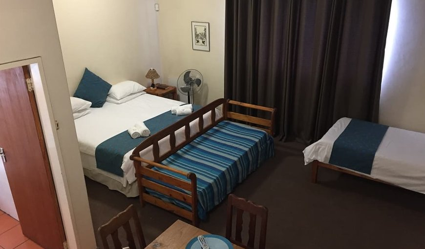 Room 2 has a double bed with a single 3/4 bed