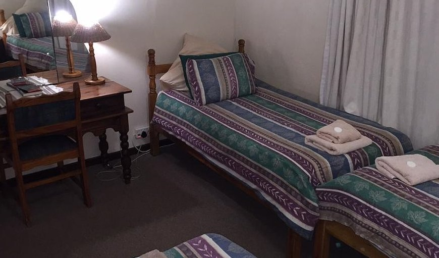 The rooms has a double bed and single bed and the 2nd room has 3 single beds