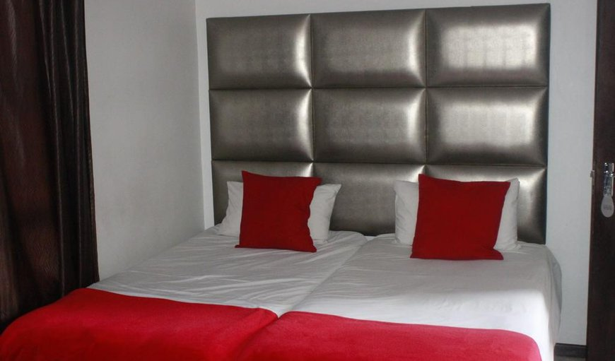 Angelshof Self Catering apartment with twin singles making a double bed.