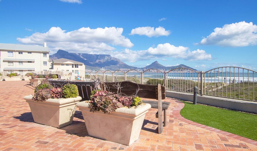 Guests can sit on the communal benches and enjoy the spectacular sea and mountain views.
