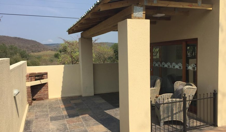 One bedroom Mango Cottage has a courtyard with braai and water feature.  Beautiful views, private parking, gated access and very private.
