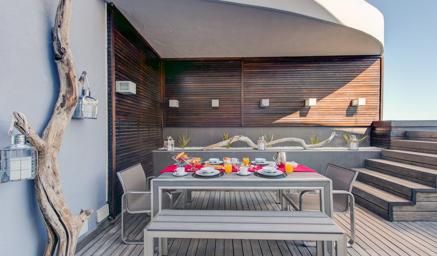 The Penthouse on Beach offers a large terrace with comfortable seating areas and a dining area.