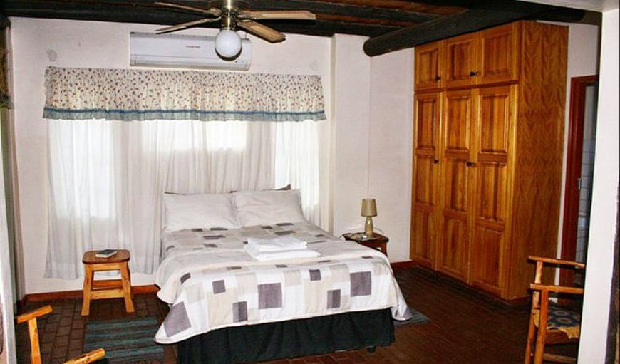 Self-Catering chalet bedroom with double bed.