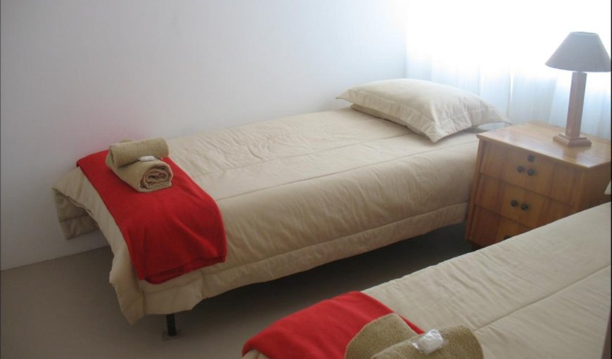 Unit 1 bedroom with twin single beds with air-con.