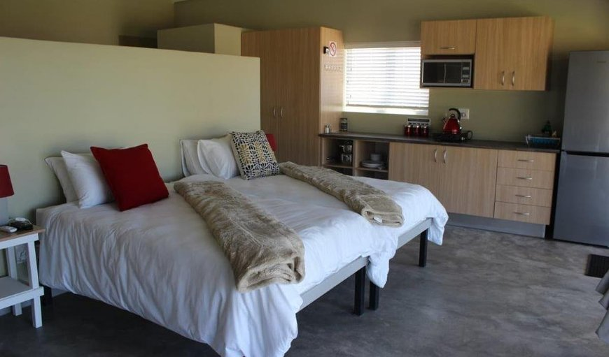 Unit 1 bedroom with twin single beds, air-con, en-suite bathroom and selected DSTV channels.