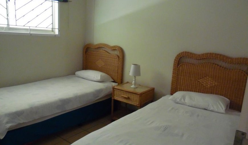 The rooms has a double bed and twin single beds