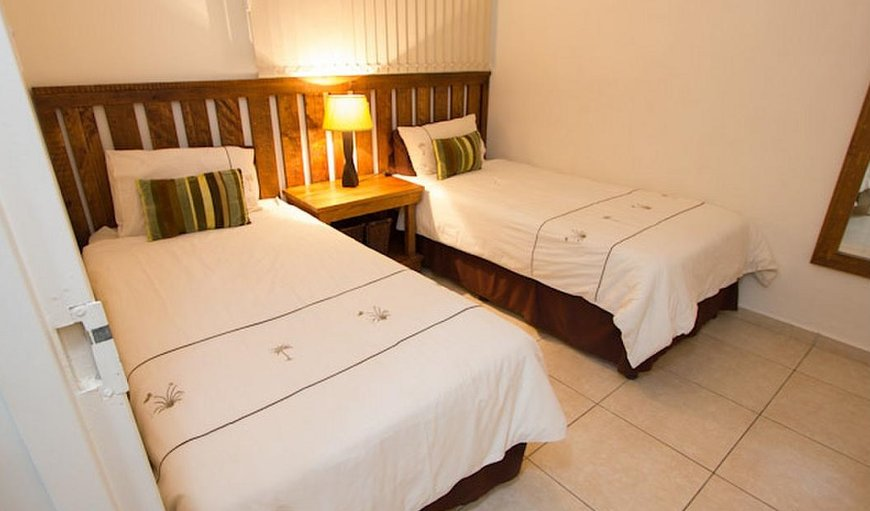 The unit has double beds and twin single beds