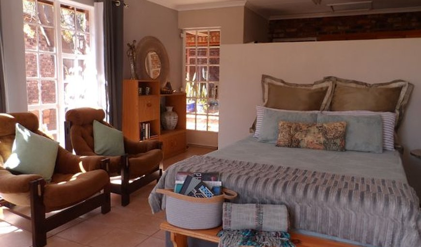 Kameelperd Cottage - Lounge area with double bed in Flamwood, Klerksdorp, North West Province, South Africa