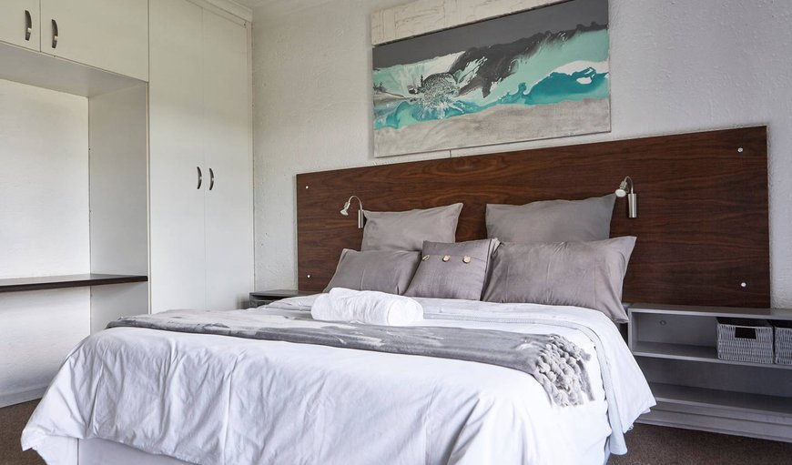 The main bedroom has a Queen-sized bed in Bredell , Kempton Park, Gauteng, South Africa
