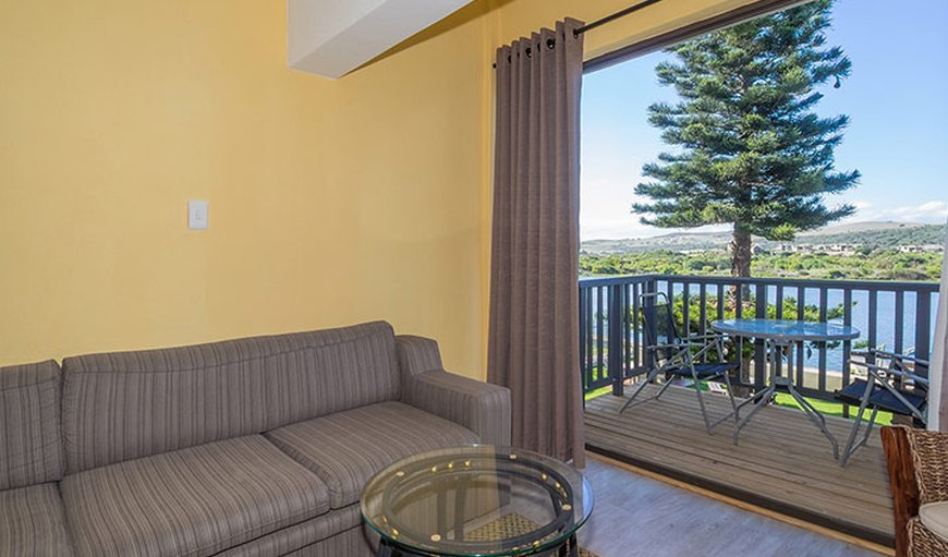 2 Bedroom Apartment with a couch and balcony area.