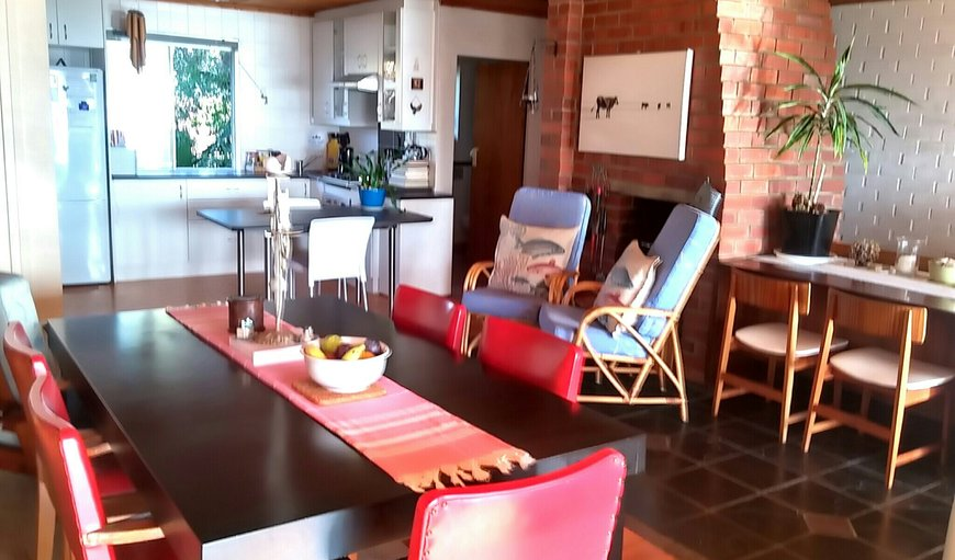 Spacious open plan kitchen and dining with in-door BBQ/Fire Place