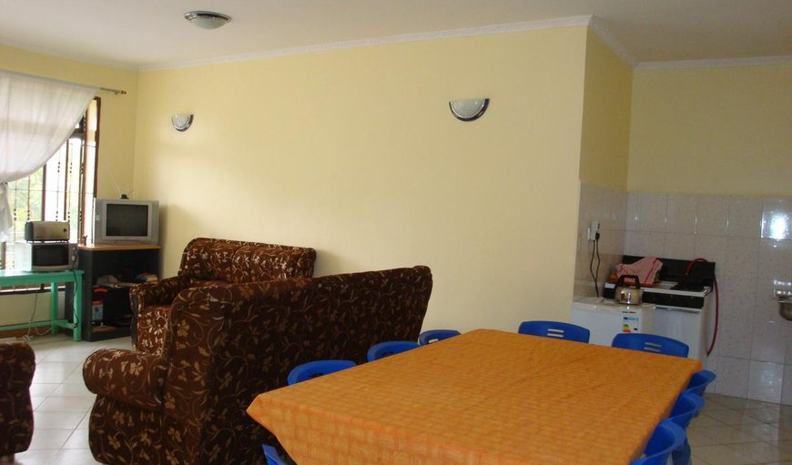 Amani Hostel shared lounge and dining area.