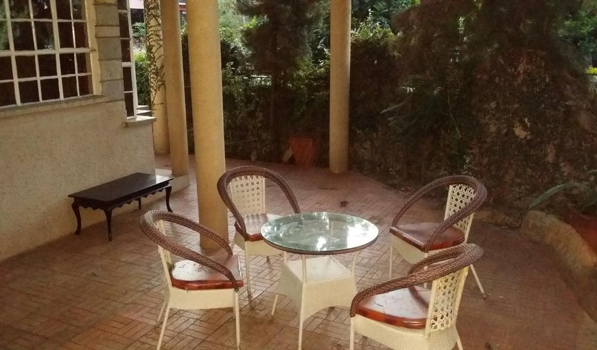Evergreen Homestay with tables and chairs on the patio.