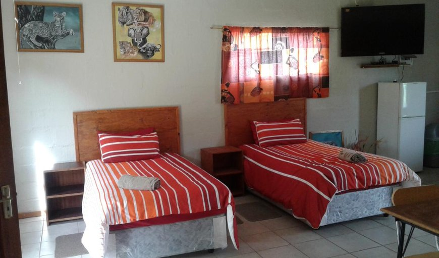 Bungalow 1 bedroom with twin single beds.