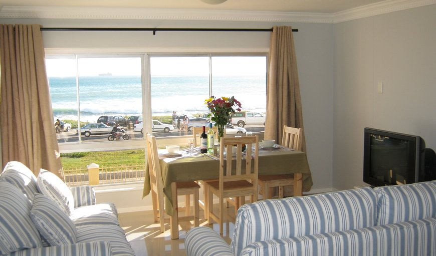 Lounge/dining area with stunning sea views. in Bloubergstrand, Cape Town, Western Cape, South Africa