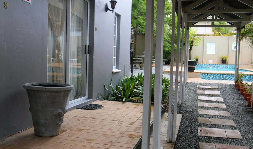 Outside area of one of the standard rooms - walkway to the swimming pool area.