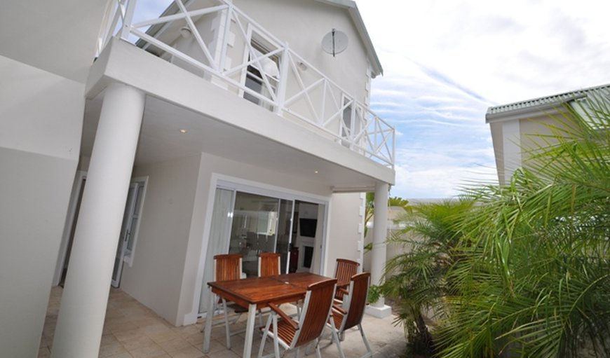 Patio downstairs with furniture and balcony upstairs in Plettenberg Bay, Western Cape, South Africa