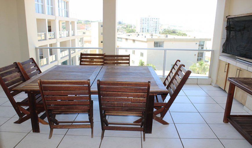 Rondevoux 18 - The apartment has a covered balcony with outdoor dining furniture and built-in braai facilities. in Uvongo, KwaZulu-Natal, South Africa