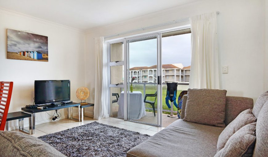 Lounge with leading doors to the patio in Muizenberg, Cape Town, Western Cape, South Africa
