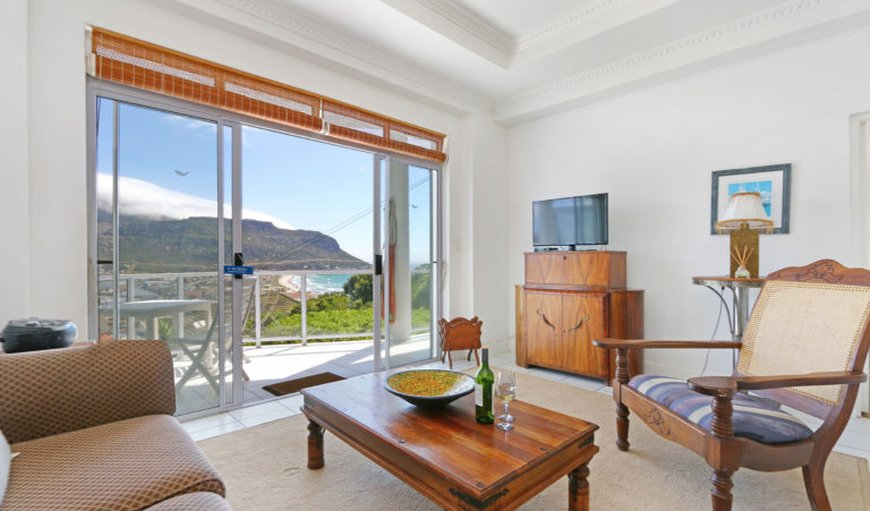 Lounge leading to a balcony with a beautiful view in Fish Hoek, Cape Town, Western Cape , South Africa
