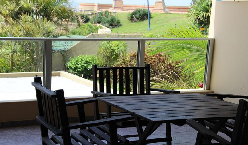 The living area has sliding doors leading out to a furnished balcony with braai facilities.