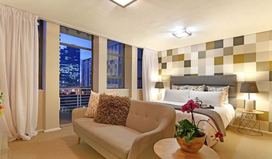 Bedroom and lounge area. in Cape Town City Centre / CBD, Cape Town, Western Cape , South Africa