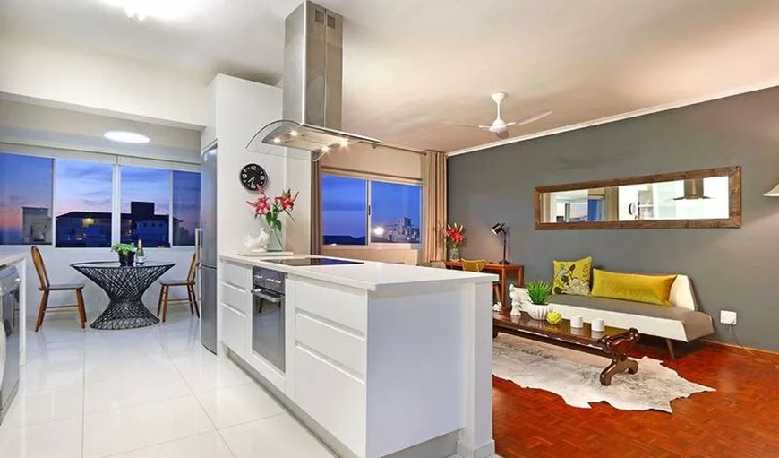 Open-plan kitchen and lounge. in Sea Point, Cape Town, Western Cape , South Africa