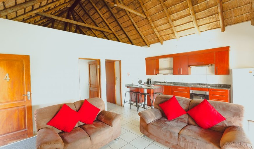 Open-plan lounge area with fully equipped self catering kitchen.