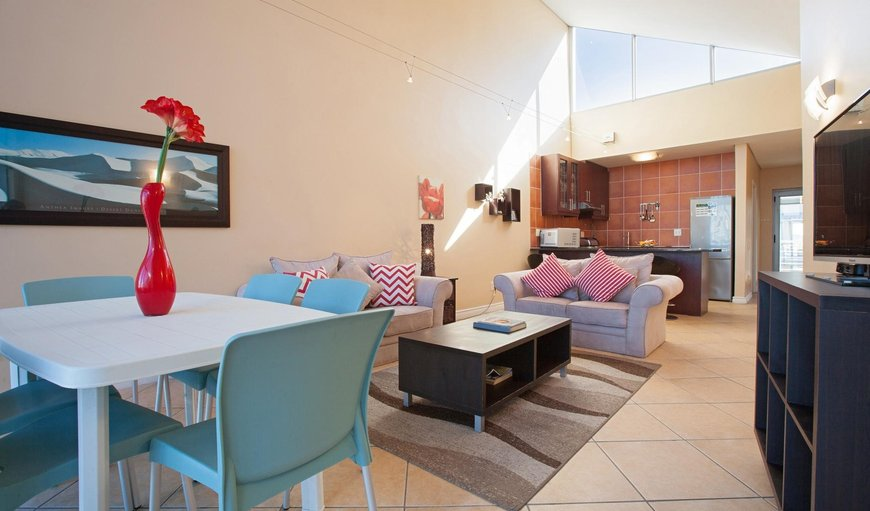 Open-plan kitchen, lounge and dining area. in Bloubergstrand, Cape Town, Western Cape , South Africa