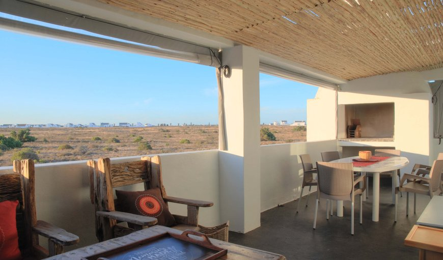 Patio area with a braai and dining table. in Britannia Bay, Western Cape , South Africa