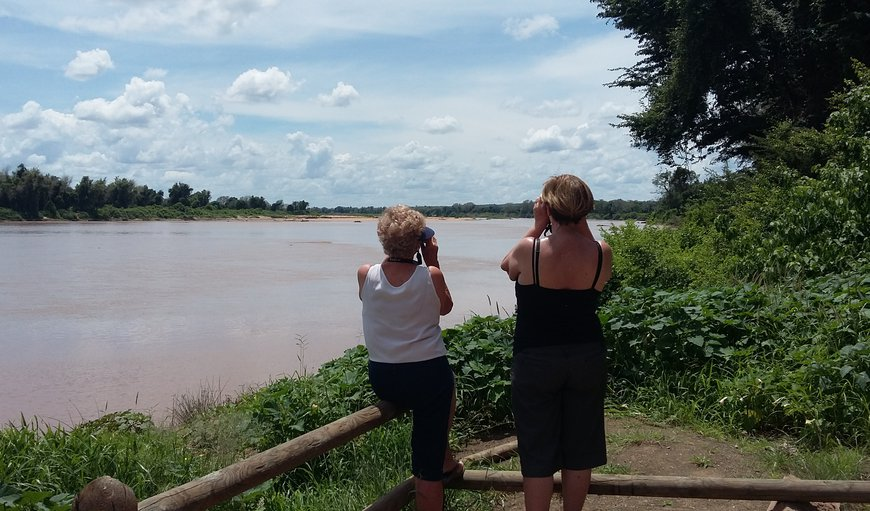 Self drive to KNP , the Limpopo River in full flow at Crooks Corner