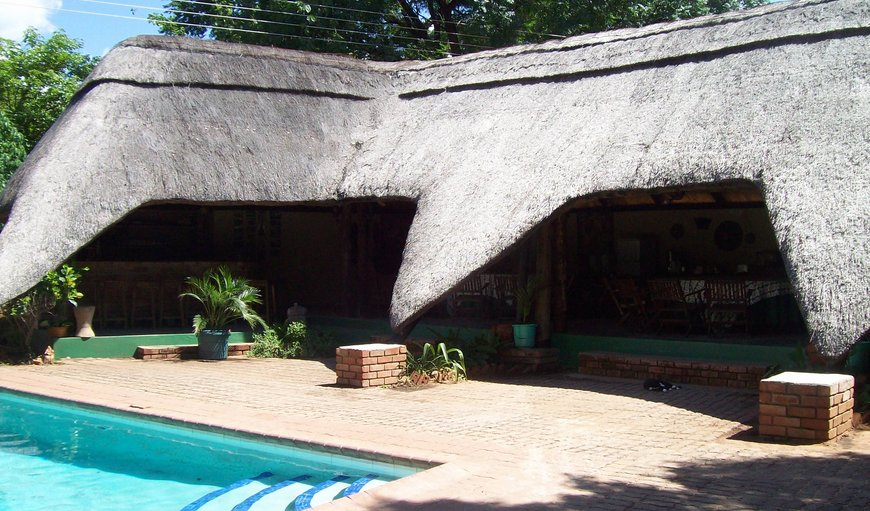 Boma area & rooms surround the pool & garden