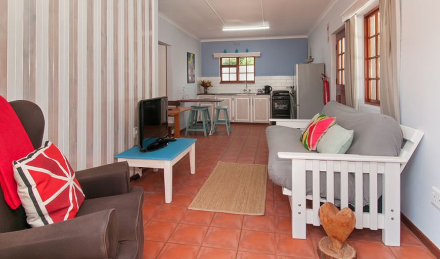 Open-plan living/dining and kitchen area in Eastcliff, Hermanus, Western Cape , South Africa