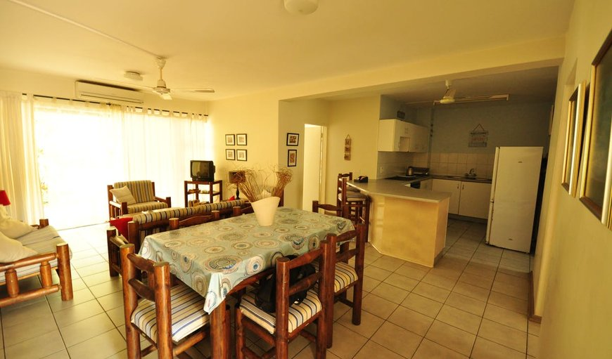 Open-plan lounge, dining area and kitchen. in St Lucia, KwaZulu-Natal, South Africa