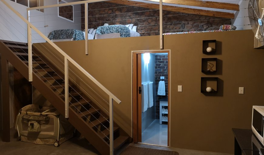 Bathroom & stairs leading to loft