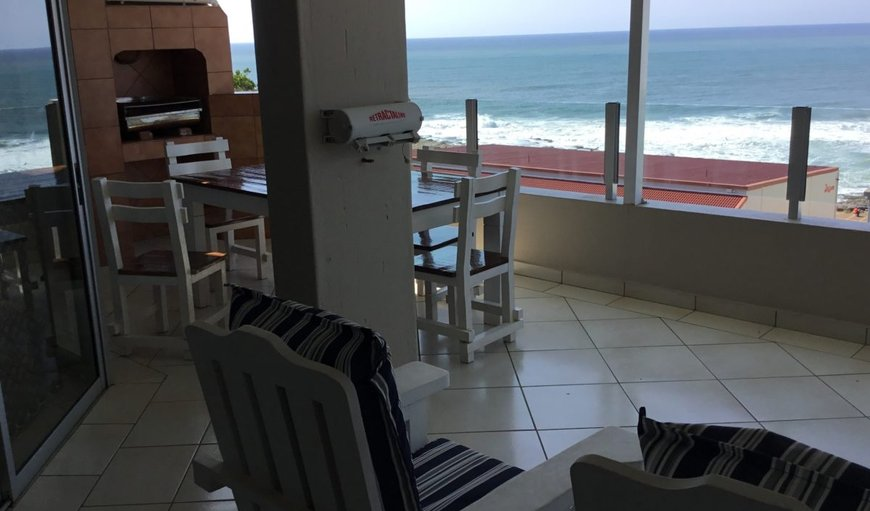 Breathtaking sea views from the covered patio/balcony with outdoor furniture and braai area in Uvongo, KwaZulu-Natal , South Africa