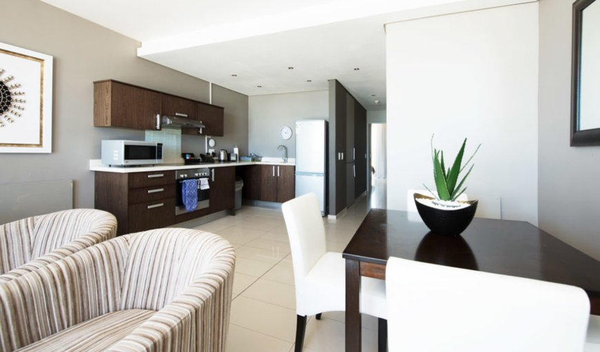 Open-plan kitchen and lounge. in Bloubergstrand, Cape Town, Western Cape, South Africa