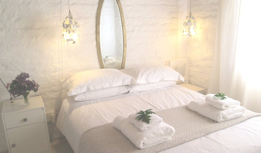 Beautifully decorated bedroom with lovely large bed in McGregor, Western Cape , South Africa