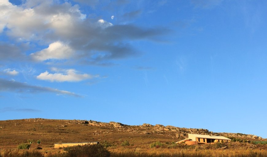 The straw bale house and shed, looking up the Platberg slope in Piketberg, Western Cape, South Africa